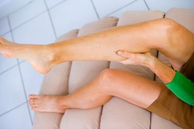 Woman With Leg Cramps --- Image by © IMANE/BSIP/Corbis